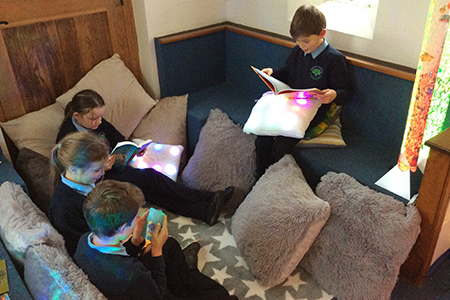 New reflection and sensory area in Okeford Fitzpaine- group of readers