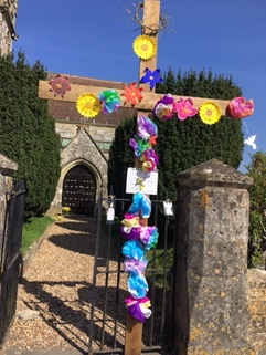 An empty tomb and a garden of Hope at Great Wishford- flowered Easter cross