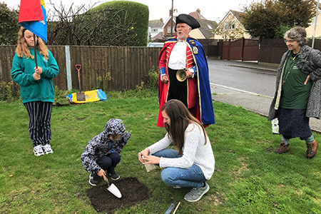 It's a God issue- Finley plants a crab apple tree with the Town Crier